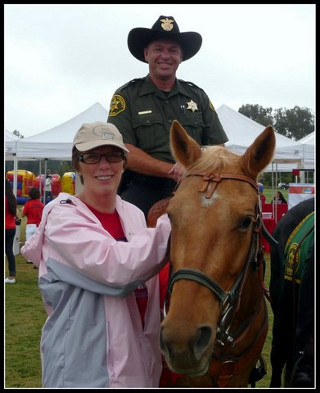 Cathy with a mounted deputy at the Walk Against Drugs